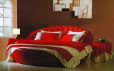 interesting-abstract-art-and-a-romantic-round-bed-make-for-an-fascinating-combination