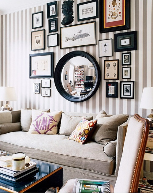 displaying photo frames on the open spaces in the rooms also makes the house to look quite engaging and inspiring like an art gallery